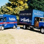 The old and new Pickfords trucks standing next to each other.