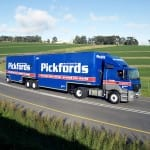 The famous red-and-blue colour schemed Pickfords truck on the road.