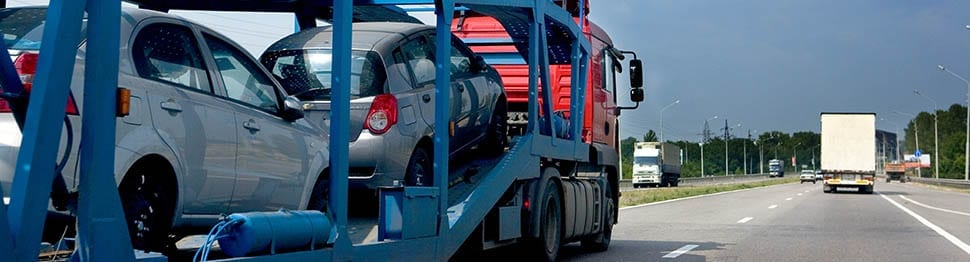Moving vehicles by car carrier offered by Pickfords Removals.
